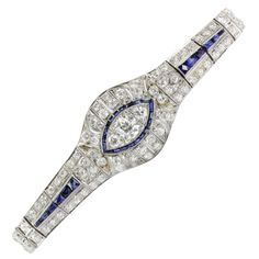 Antique Art Deco Platinum Tennis Bracelet w/ 10 Carats of Diamonds & Sapphires. The bracelet is in excellent original estate condition and ready to wear. It is blanketed in approximately 9 carats of o