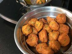 Make delicious Aloo Bondas at home for snacks.