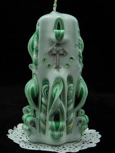 Check out this item in my Etsy shop https://www.etsy.com/listing/210126258/hand-carved-celtic-candle-green-gold-and