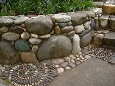 Rock Retaining Wall With Spirals River Rock Retaining Wall With Spirals - thinking this would work with my field stone, too!River Rock Retaining Wall With Spirals - thinking this would work with my field stone, too! Garden Paths, Garden Art, Garden Landscaping, Landscaping Ideas, Garden Edging, Mosaic Garden, Mosaic Walkway, River Rock Landscaping, Rock Walkway