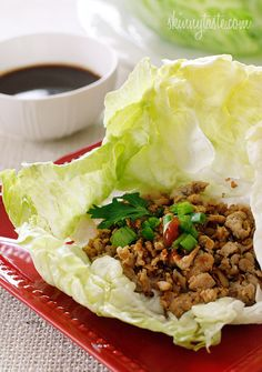 shiitake mushrooms and water chestnuts seasoned with Asian spices are served in a crispy cold lettuce leaf with a spicy hoisin dipping sauce...