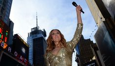 """A wax figure of Canadian singer Celine Dion is unveiled by Madame Tussauds New York, at the heart of Times Square in New York, October 8, 2013. The Canadian superstar's wax figure is visiting New York after being on display at Madame Tussauds Las Vegas, posing in a performance stand, ahead of Dion's new album, """"Loved Me Back to Life"""", to be released on November 5, 2013. AFP PHOTO/Emmanuel Dunand"""