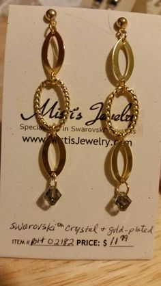 The Swarovski Crystals are a smokey grey color and the links are gold plated.