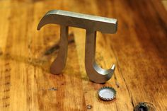 Pi Bottle Opener Bring a piece of art to your bartop or countertop. A simple design based off an irrational number. For the math lover, scientist, engineer, or anyone who appreciates a perfect circle and an open beer.