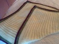 Half double crochet in back loop, single crochet around...new throw.