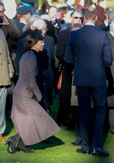 The Duchess is seeing curtsying the Queen after watching Her Majesty lay a wreath in memor...