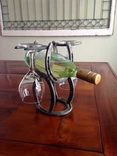 Horse Shoe Wine Rack by DonnellyFarms on Etsy https://www.etsy.com/listing/227293797/horse-shoe-wine-rack