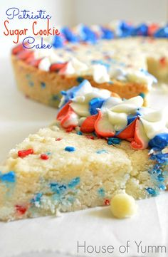 Celebrate the Fourth of July with this Patriotic Sugar Cookie Cake.  This sugar cookie cake is loaded with white chocolate chips and red whi...