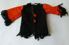 Faerie Glen orange and black top. This has matching pants and there is also a blue variation eBay.com