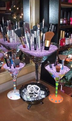Display brushes in martini glasses for a more GLAM feel :)