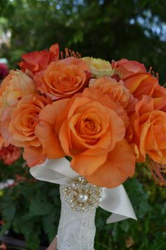 Vintage orange rose bridal bouquet. Fleurish Floral Designs