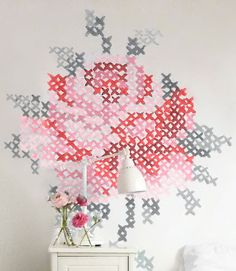 Swap a needle and thread for a brush and paint to re-create this oversize riff on an embroidered rose, by Dutch artist Eline Pellinkhof. Don't worry: You won't have to freehand it. Get the tutorial at Country Living »   - CountryLiving.com