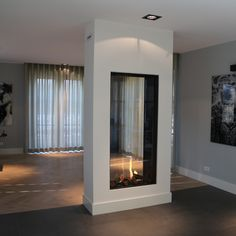 Modern see-through fireplace in sleek surroundings Foyer and Entryway Ideas fireplace Modern seethrough Sleek surroundin. - Modern see-through fireplace in sleek surroundings Foyer and Entryway Ideas fireplace Modern seethrough Sleek surroundings - Home Fireplace, Modern Fireplace, Living Room With Fireplace, Fireplace Design, Fireplace Ideas, Fireplaces, Chimenea Simple, See Through Fireplace, Living Room Flooring