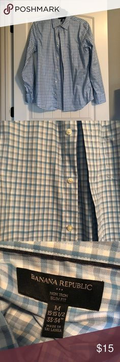 Men's Banana Republic Button Down Top Excellent used condition men's non-iron slim fit button down. Measurements are in photos. Pattern includes colors that are blue, gray, and white. 100% cotton. Smoke free home. Banana Republic Tops Button Down Shirts