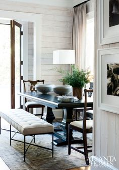 The nook in Robert Brown's Lake Hartwell retreat provides a formal dining option, with an upholstered iron bench from Oly Studio and dining chairs form Holland & Company.
