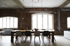 LOVE exposed brick and how open the windows make this room