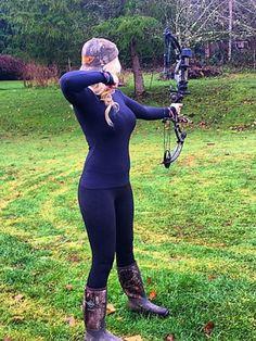 Naked girls shooting bows