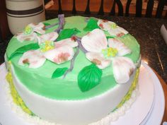 Yummy Strawberry-Lemon Cake with light green buttercream frosting and dogwood blossoms from marshmallow fondant (Side view)