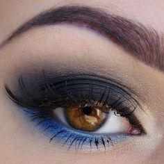 Add a swipe of royal blue eyeshadow along the lower lash line to inject some color to a black smokey eye look.
