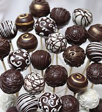 Who doesn't like cake pops?! I think we could easily sell them at our fundraiser in the bake sale section.