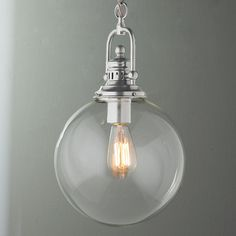 Clear Glass Globe Industrial Pendant A clear glass globe is suspended from industrial inspired hardware in your choice of Bronze, Polished Nickel or Brushed Nickel. A clean and clearly stylish choice for your kitchen or bar, exclusively from Shades of Light. Add our vintage Edison bulb for a different twist