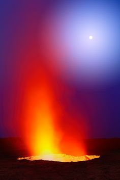 The Witching Hour: A full moon rises during twilight at Erta Ale, Ethiopia, as the volcano belches out yet another gout of red-hot gas and ash. Erta Ale is home to one of the world's only permanent lava lakes.