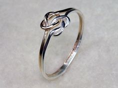 Mini Celtic Double Love Knot Ring with Argentium Silver and 14kt Gold Filled. $20.00, via Etsy.