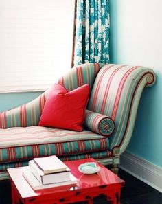 What a cozy corner, I may never leave. Turquoise and Red Chaise...