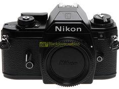 Blackdove-Cameras > Nikon EM nera, reflex automatica a pellicola, perfettamente funzionante.