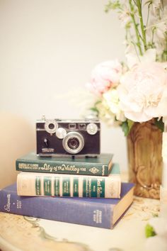 I'm all about the older camera styles. And the books. I could decorate a thousand rooms with books.