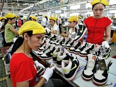 Nike factory in China producing Nike trainers. I wonder how many hours these workers worked for...?