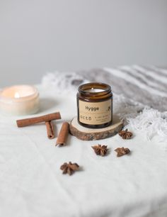 HYGGE - CINNAMON, CLOVE, NUTMEG, ORANGE ESSENTIAL OIL CANDLE. NATURALLY SCENTED SOY WAX CANDLE IN AMBER GLASS JAR WITH LID (ESSENTIAL OILS ONLY)  // Hygge - No. 04 //  This is a truly wonderful candle, made to warm and lift the spirits, snuggle down with a hot chocolate in front a crackling log fire with your favourite book, surrounded by loved ones and enjoy a hygge moment…  A heartwarming combination of zesty orange, spicy cinnamon, sweet vanilla, nutmeg, ginger and clove.  Christmas…