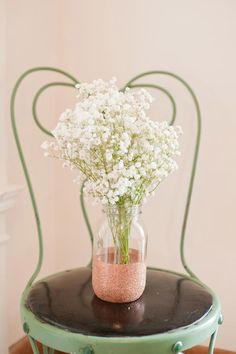 For centerpieces, maybe instead of vintage bottles. DIY glitter vases from The Sweetest Occasion