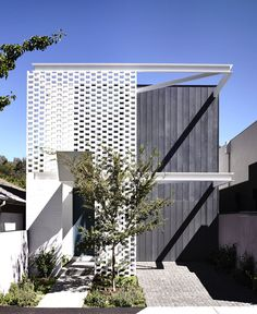 Melbourne House Created by Inglis Architects brick perforated screens steel cantilevers