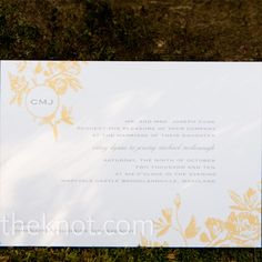 The simple, elegant invitations came from an unlikely source: Costco.com! The gray script and yellow and orange floral graphic was printed on a heavy ecru stock for a luxury feel at a bargain price.