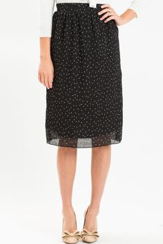 This gorgeous crepe polka dot midi skirt is our new favorite Fall bottom! The lightweight and flowy feel of this skirt makes us want to wear it all year long, and we love how you can do so with a pair