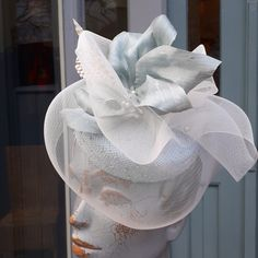 Natural knotted straw bellhop hat with veil silk curls and feathers