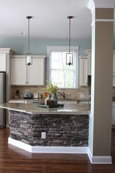 Love the stone base kitchen island! Great so you dont the the scuff and kick marks when your kids are sitting there!!
