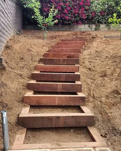 garten treppe Built a nice set of timber garden stairs today up an embankment that will have a Sloped Yard, Sloped Backyard, Landscape Stairs, Sloped Landscape, Landscape Timbers, Landscape Architecture, Landscape Designs, Timber Stair, Hillside Landscaping
