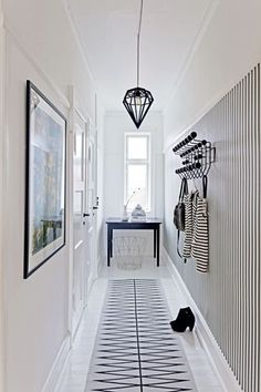 Do you to make your long narrow entryway or hallway appear bigger? These narrow entryway ideas will help your entryway make a strong first impression. Narrow Entryway, Interior, Home, Entryway Lighting, Scandinavian Home, House Styles, White Interior, Amber Interiors Design, Narrow Hallway Decorating