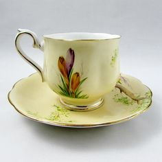 Made by Royal Albert, this beautiful tea cup and saucer has hand painted flowers and gold trimming. Pattern is Crocus. Excellent condition (see photos). Markings read: Crocus Royal Albert Crown China England Please bear in mind that these are vintage items and there may be small