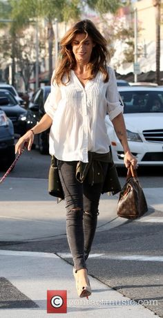 Elisabetta Canalis spotted out walking her dog wearing a white shirt, ripped jeans and heels