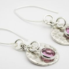 You'll love these minimalist October hammered round Hill Tribe silver earrings – simple and trendy! Earrings showcase Swarovski crystal charms in fabulous pink tourmaline which is the traditional birthstone for the month of October.