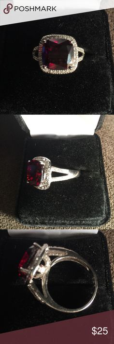 .925 Sterling Silver Man Made Garnet Ring 18K White gold over .925  sterling  silver and 6.45ctw  Garnet and white sapphire ring. Total wait for the ring is 6.60 grams. Size 8. Jewelry Rings