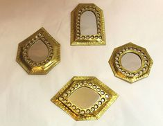 """These beautiful mirrors are handmade in Morocco. Unique wall decor. Mix and match to crate a special pattern. The price is for one mirror. Drop: 3.5""""H x 2.875""""W. 