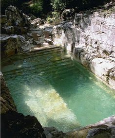 Backyard pool built into limestone quarry