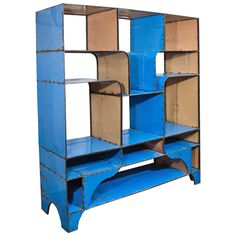 """""""This étagère is inspired by 20th century French designer Jean Prouve and it's made out of recycled African oil barrels. I love the eye-catching cobalt blue and the use of recycled materials. So much of African design is so inventive. It's also from the amazing antiques dealer Liza Sherman, whose apartment was featured in ELLE DECOR.""""    Offered by Liza Sherman    - ELLEDecor.com"""