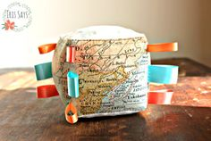 Old world map soft taggie block toy for baby on-the-go by Iris Says #handmade #toy #baby #children #taggie #ribbons #vintage #traditional #elegant #nursery #babyshower #gift #present #dreamy #turquoise #peach #coral #pink #cream #green #geography #learn #sensory #play #fun