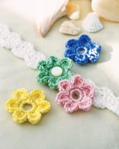 Blooming Headband | crochet today. It's a back order pattern but this looks simple enough to make...