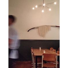 Our Long Cord Chandelier in white Sama Sama Kitchen in Santa Barbara via Shelter Social Club #yourspaceourlights | www.brendanravenhill.com